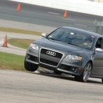 Audi RS4 lifts a wheel at NHMS